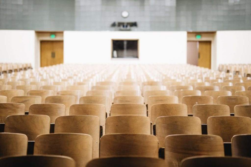 Photograph of rows of empty seats in an auditorium.