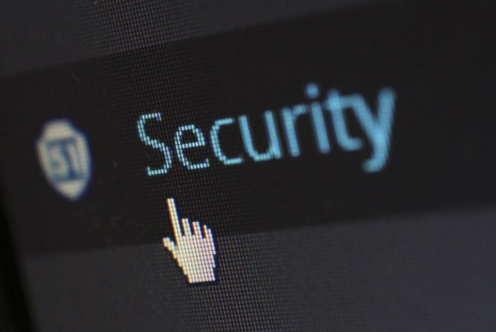 Hand clicking on security