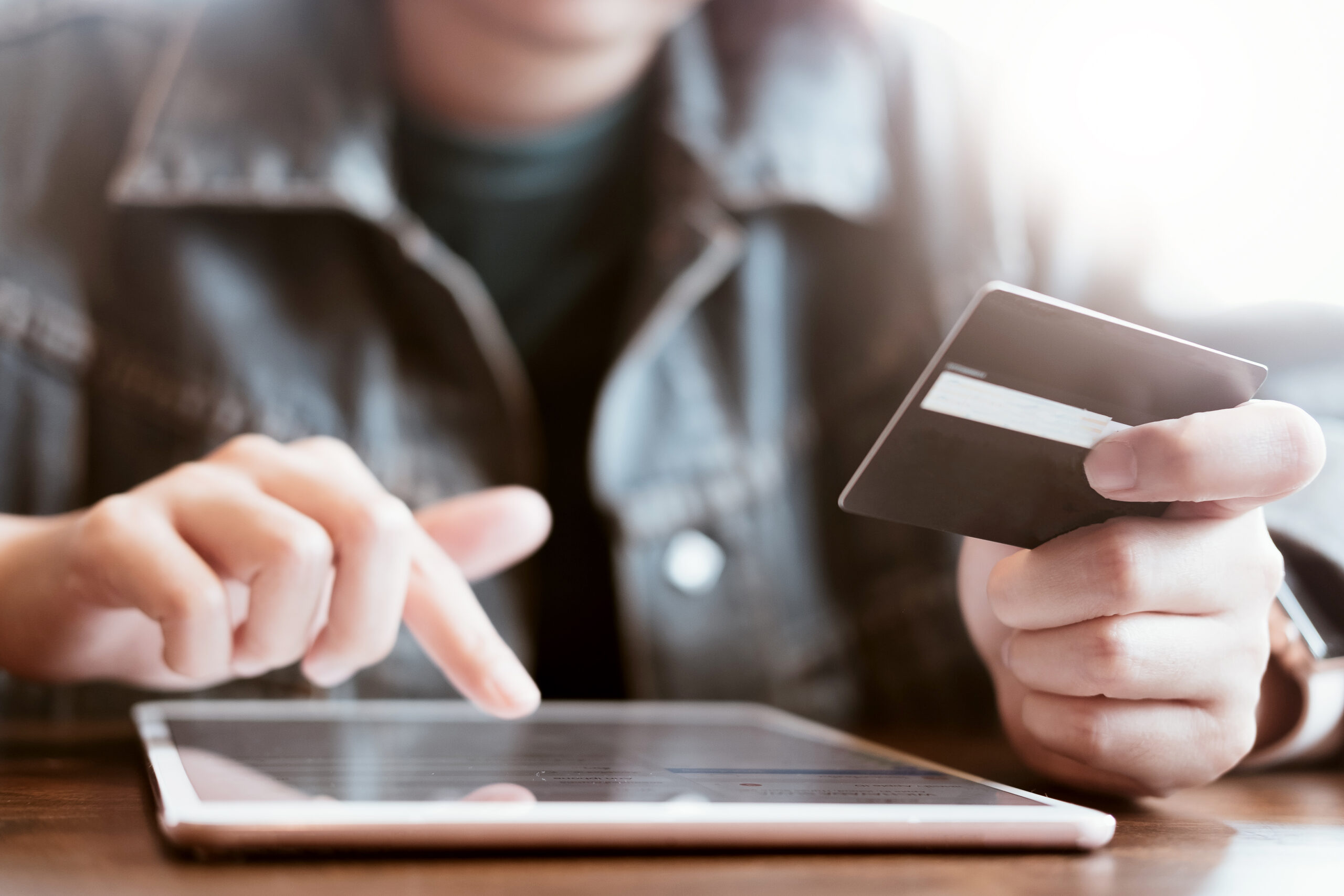 women hold card and use tablet on wood table,Online shopping,hands holding credit card and using laptop