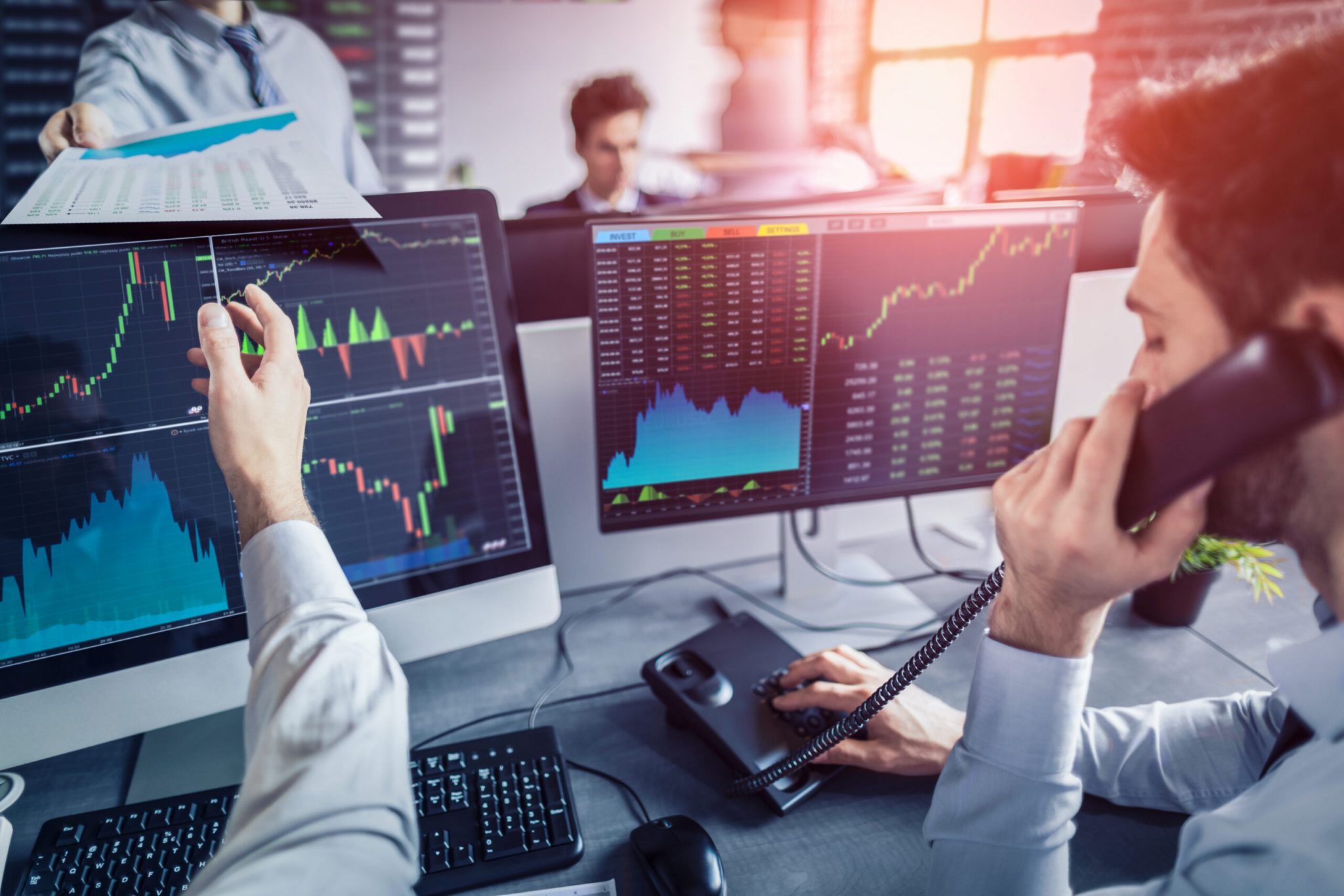 Business team deal on a stock exchange. Stock traders concept